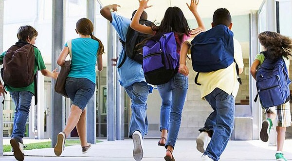 Kids with backpacks, school supplies, excited for school