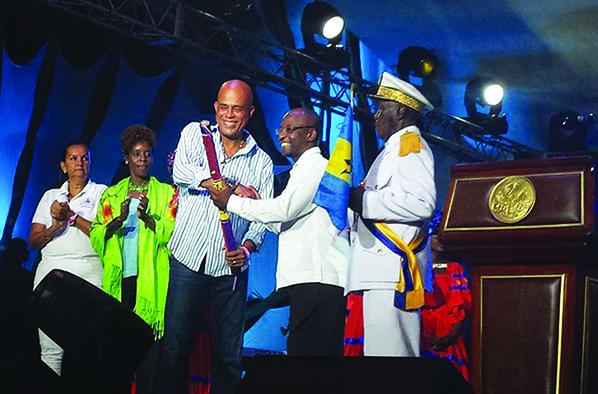 Haiti President presents baton