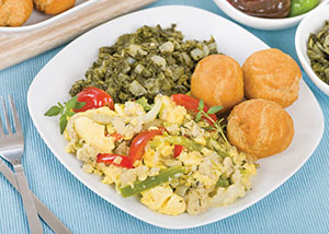 Ackee & Saltfish: a traditional Jamaican dish made of salt cod and ackee fruit. Served with callaloo and johnny cakes. Photo credit: © Can Stock Photo Inc.  paulbrighton.