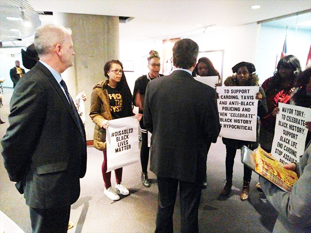 Mayor John Tory listens to the concerns of the protesters. Photo credit: Black Lives Matter-Toronto.