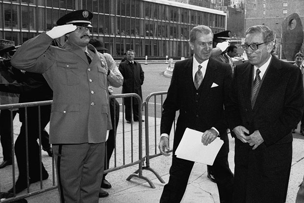 On January 2, 1992, Boutros Boutros-Ghali (right), Secretary-General of the United Nations, arrives at the Secretariat Entrance for his first working day at the United Nations. Aly Teymour, Chief of Protocol, escorts him into the building. UN Photo/John Isaac.