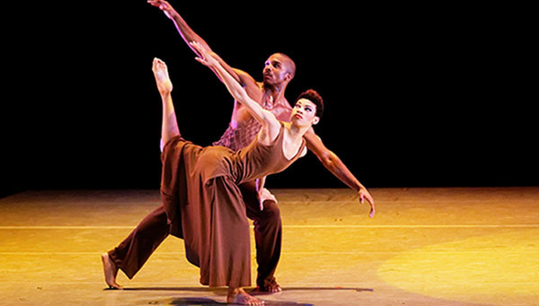 "Alvin Ailey American Dance Theater's Michael Jackson Jr. and Ghrai DeVore in Alvin Ailey's ""Revelations"". Photo by Pierre Wachholder."