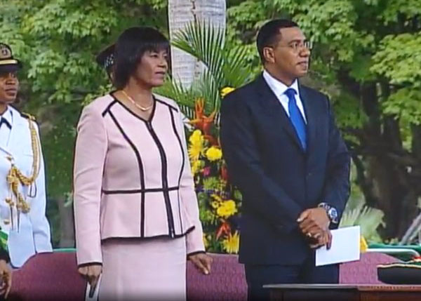 Handing over: Andrew Holness and Portia Simpson Miller, at the G-G House grounds before the swearing-in ceremony.