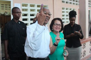 President David Granger and his wife, show off their fingers after voting.