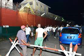 Onlookers outside the Georgetown Prison. (File Photo).