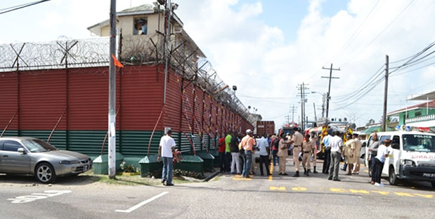Guyanese citizens gather outside the Camp Street prison after the rioting. Photo credit: GINA.