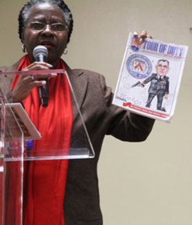 "Valerie Steel displays the Toronto Police Association cover, featuring a derogatory caricature of Sloly that she found ""disrespectful"". Photo by Kingsley Gilliam."