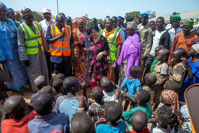Special Representative of the Secretary-General for Children and Armed Conflict Leila Zerrougui (centre), meets displaced children and their families in northeastern Nigeria, in January 2015. Credit: UN.