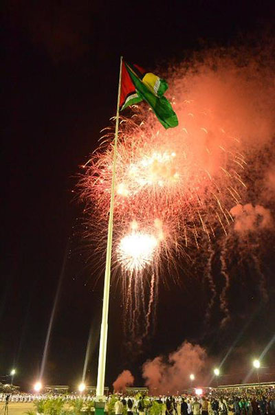 Guyana @ 50. The Golden Arrowhead flies high as the fireworks go off in the background. Photo credit: GINA.