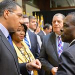 Jamaica Prime Minister, Andrew Holness (left), in discussion with Grenada's Prime Minister, Dr. Keith Mitchell (right), at the Caribbean Development Bank's (CDB) Board of Governors Meeting at the Montego Bay Convention on May 18. At centre is Jamaica's Minister of Finance and Public Service, Audley Shaw. Holness is pursuing a debt swap initiative with the World Bank, similar to one that Mitchell has approached Germany about. Photo credit: Garwin Davis/JIS.