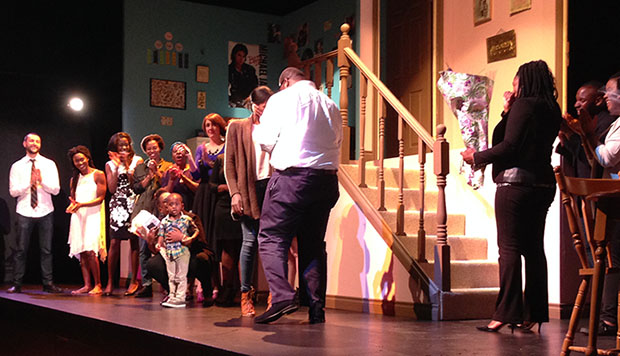 "A real-life marriage proposal, involving Trey Anthony's sister and her partner (guy whose back is to the camera) of North Carolina, was made, on stage, at ""How Black Mothers Say I Love You"". Photo credit: Neil Armstrong."