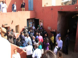 Visitors to Senegal stand inside the courtyard of the only remaining slave house on Gorée island. (CMC photo).