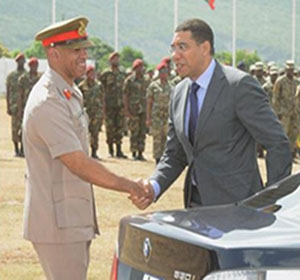 Prime Minister Andrew Holness (right) being greeted by Chief of Defence Staff, Major General Antony Anderson. Photo credit: CMC.