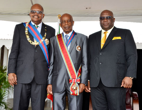 Sir Kennedy Simmonds, centre, pictured with Prime Minister, Dr. Timothy Harris, right, and Governor General, Samuel Weymouth Tapley Seaton, after being conferred with the St. Kitts-Nevis' Order of National Honour.