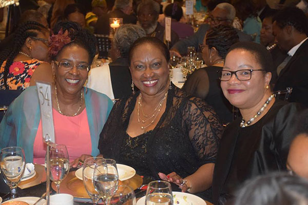 Award-winning author and entrepreneur, Itah Sadu, left, who expertly emceed the gala, poses with Dauna Jones-Simmonds, centre, and Dr. Denise O'Neil Green, two of the book's co-authors. Photo credit: Gwyneth Matthew-Chapman.