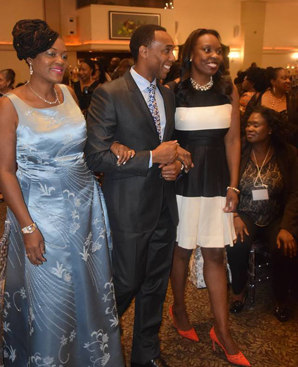 "CBC TV news Anchor, Dwight Drummond, seems to be having a ball escorting ""100 Accomplished Black Canadian Women – 2016'' honourees, Sharon Joseph, left, and Ontario MPP, Mitzie Hunter, who was recently appointed as the province's Minister of Education. Photo credit: Gwyneth Matthew-Chapman."
