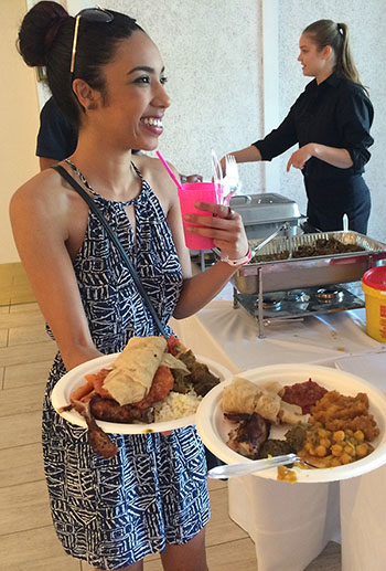 Getting her money's worth of premium delicasies at the Toronto fundraiser.