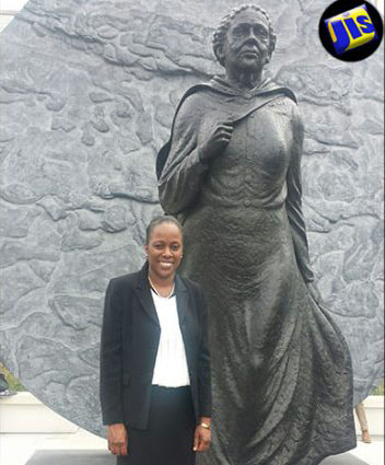 Jamaica's Acting High Commissioner to the United Kingdom (UK), Diedre Mills, stands next to the memorial statue in honour of Jamaica-born Mary Seacole, which was unveiled in the gardens of the St. Thomas Hospital on June 30. Photo credit: Vivienne Siva/JIS.