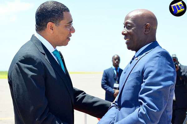 Jamaica Prime Minister, Andrew Holness (left), greets Dr. Keith Rowley, Prime Minister of Trinidad and Tobago, on his arrival at the Norman Manley International Airport yesterday (July 17), for the start of an Official Visit to the island. Photo credit: Yhomo Hutchinson/JIS.