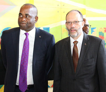 CARICOM Chair and Dominica's Prime Minister, Rooseveldt Skerrit, accompanies CARICOM Secretary-General, Ambassador Irwin LeRocque, into the Summit. Photo credit: CARICOM Secretariat.