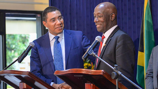 Trinidad and Tobago Prime Minister, Dr. Keith Rowley, right, met with Jamaica's Prime Minister, Andrew Holness, earlier this year.