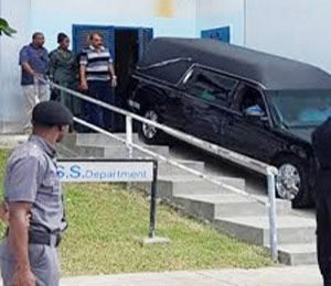 A hearse takes away the body of former T&T Prime Minister, Patrick Manning.