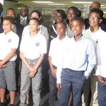 Boys from the 100 Strong's summer school program, Strong Academy, pose with Justice Donald McLeod (seventh from left), one of the co-founders and co-chair of the organisation; officials from Ryerson University; and Black politicians, who were attending the second annual Canadian Black Government Leaders Summit. Photo by Michael Van Cooten.