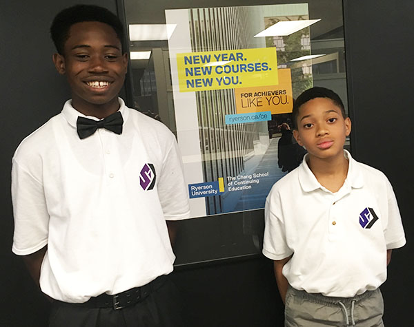 Jalanni Sylvester-Hilaire, 14, left, and Caleb McLeod, 13, right, of the Strong Academy, a summer school program established by the 100 Strong Foundation which was held at Ryerson University for 25 black boys. Photo credit: Neil Armstrong.