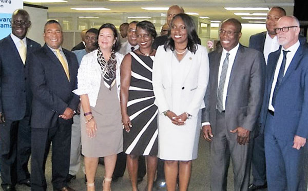 Ontario Education Minister, Mitzie Hunter (fourth from right) and MP Celina Caesar-Chavannes (sixth from right), Parliamentary Secretary to the PM, are seen with (from left to right): Emanuel Du Bourg, MP for Bourassa, Quebec; MLA Tony Ince, Nova Scotia Minister of Communities, Culture and Heritage and African Nova Scotian Affairs; an unidentified official from 100 Strong Foundation; Dr. Marie Bountrogianni, dean of The Chang School of Continuing Education; Stephen Gough, MLA for Sackville-Beaver Bank, Nova Scotia; Ahmed Hussen, MP for York South-Weston; Granville Anderson, MPP for Durham, Ontario; Michael Coteau, Minister of Children and Youth Services and Minister Responsible for Anti-Racism; and Dr. Christopher Evans, Interim Provost and Vice President Academic, Ryerson University. Photo by Michael Van Cooten.