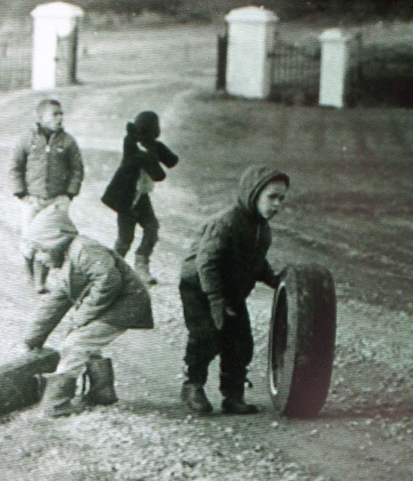 Tony Smith, seen playing as a child (rolling tire) with other orphans in the yard of the now-infamous school. Photo credit: Nova Scotia archives.
