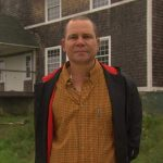 Tony Smith stands in front of the original building of the Nova Scotia Home For Coloured Children.