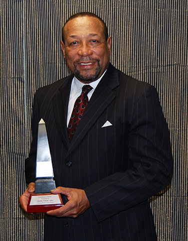 Chuck Ealey seen with the African Canadian Achievement Award for Excellence in Sports, which he received in February, 2013. Photo credit: ACAA.