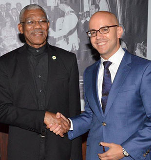 Juan Gonzalez seem meeting Guyana's President, David Granger, last year.