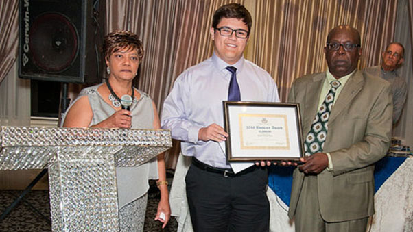 Connor Choy, centre, receives his bursary from Sharmon Carrington, left, President of the Central High School Alumni Association of Guyana (Canada)-Toronto chapter, and Christopher Moriah, a member of the Bursary Committee. Photo by Colin Rowe.
