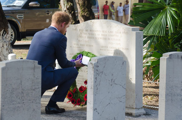 Prince Harry lays a wreath at the Commonwealth War memorial graves.