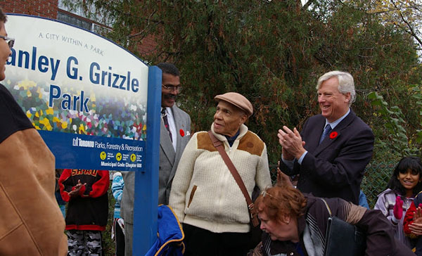 Stanley G. Grizzle is flanked by his son, Stanley E. Grizzle (left) and Toronto Mayor, David Miller, at the naming of a park in his honour across from Main Subway Station on November 1, 2007. One of his grandsons, left, enjoys the moment. Photo credit: Francine Buchner.