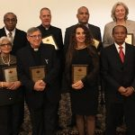 Back row (left-right): Antoine Derose, Father Michael Corcione, Akwatu Khenti and Annik Chalifour. Front row (left-right): Mohini Basran, Father Claudio Moser, Maria Masucci, Dr. Eric Pierre and Dr. Joelle Fareau at the 6th annual fundraising gala of Pierspective Entraide Humanitaire. Photo credit: Neil Armstrong.