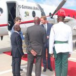Prince Harry being met by Foreign Minister, Carl Greenidge (second from left) and British High Commissioner Greg Quinnon (left) on his arrival in Guyana. (News Source Photo).