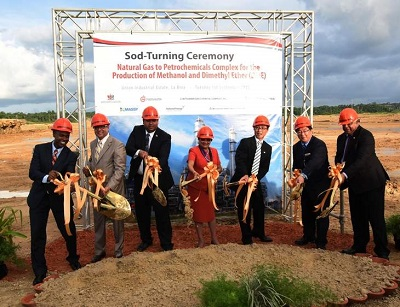 Then Prime Minister, Kamla Persad Bissessar (center) at sod-turning ceremony in 2015 (CMC file photo).