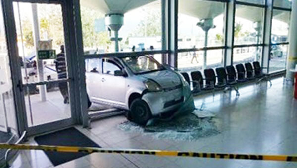 Car Crashes Into Manley Airport Departure Lounge; Two Injured
