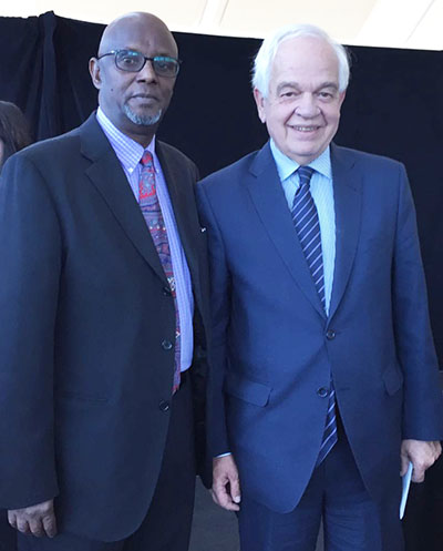 Ibrahim Absiye, left, and former Immigration Minister, and John McCallum.