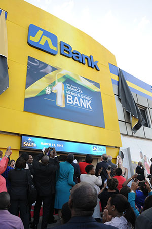 The new JN Bank sign at the company's main office in Half-Way-Tree, St Andrew is unveiled to fanfare during a ceremony on February 1.