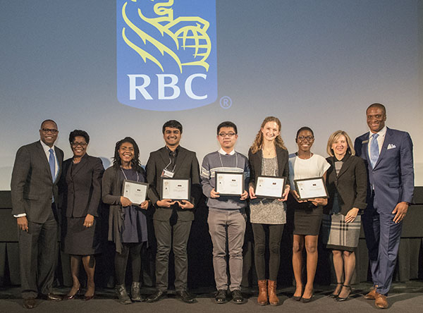 Posing for a group photo are (L-R): Mark Beckles, Head, RBC Insurance Advice Centre; Harriet Thornhill, Vice President, RBC Advice Centre; Maya George; Pronoy Chaudhuri; Andrew Yin; Sarah Konermann; Kharissa Edwards; Kris Depencier, Regional President, Greater Toronto, RBC; and Wayne Griffith, RBC Regional Vice-President. Photo contributed.