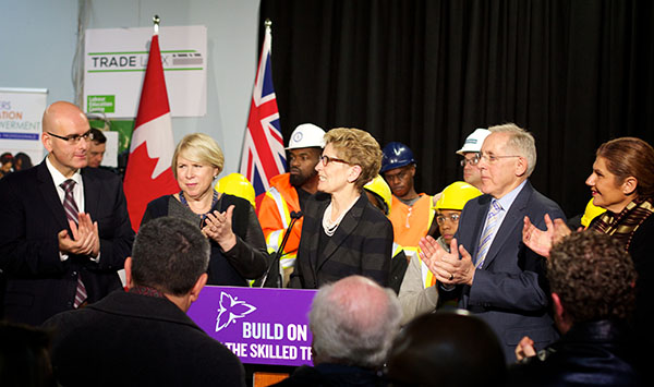 Premier Wynne (at podium) spoke of setting goals of 10 percent of the work hours from the Crosstown transit project to be performed by apprentices or journey-persons from diverse communities. Photo contributed.