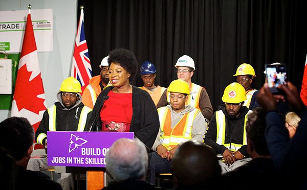 "Rosemarie Powell (at podium), Executive Director of the TCBN says,""I am optimistic that this transit build will continue to stir economic activities in the neighbourhood."" Photo contributed."