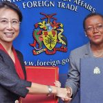 Minister of Foreign Affairs and Foreign Trade, Senator Maxine McClean, right, seen shaking hands with Ambassador of the People's Republic of China to Barbados, Wang Ke, following the signing of a protocol for the Provision of Military Aid Gratis to Barbados on Monday, December 10, 2016, when the visa waiver agreement was first announced. Photo credit: A. Miller/BGIS.
