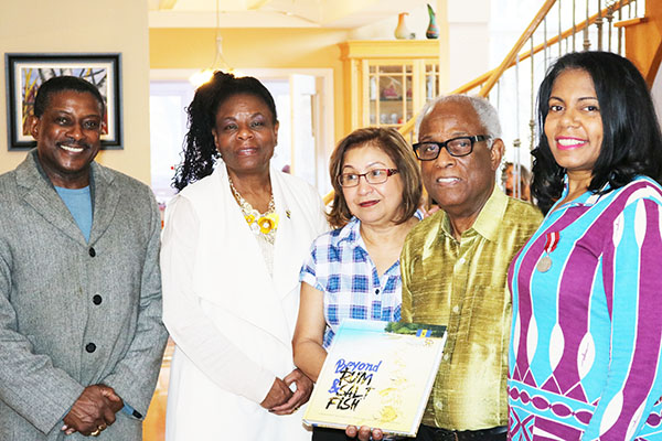 Kathy Grant (right), President of Legacy Voices and First Vice-president of the Ontario Black History Society (OBHS), who was one of the accomplished Barbadian Canadians profiled in the souvenir book, poses for a photo with, from left to right: Michael Van Cooten, Publisher and Editor of Pride News Magazine and Founder, and CEO of the African Canadian Achievement Awards of Excellence (ACAA); Yvonne Walkes, Jamaica's High Commissioner to Canada; Patricia Sammy and her husband, Dr. Grant Morris. Photo contributed.