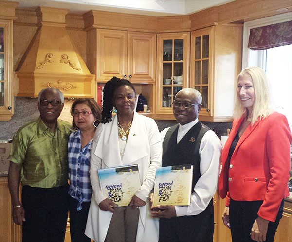 "Dr. Grantley Morris, left, presented copies of ""Rum & Salt Fish"" to Barbados' High Commissioner to Canada, Yvonne Walkes (centre), and the country's Consul General at Toronto, Haynesley Benn (second from right). Also in photo is Patricia Sammy (second from left) and Barbara Trieloff-Deane (right). Photo by Michael Van Cooten."