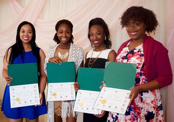 Chauntae De Gannes, left, join other scholarship winners (from left to right) Melanie Manning, Brianna Hylton and Eileen Adams, as they display the scholarship awards they received from the Congress of Black Women-of Canada (Ajax-Pickering chapter). Photo courtesy of (CBWC).