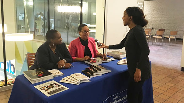 "Dauna Jones-Simmonds, left, and Dr. Denise O'Neil Green, co-authors of the book, ""100 Accomplished Black Canadian Women,"" being interviewed. Jean Augustine is also a co-author of the book. Photo by Neil Armstrong."